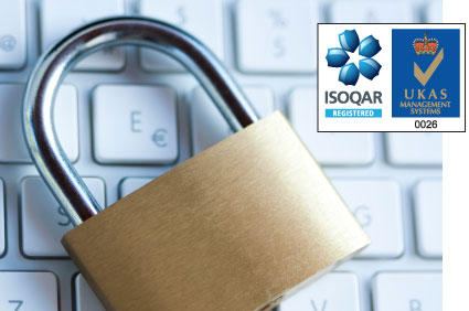 Padlock on computer keyboard and ISOQAR 27001 logo