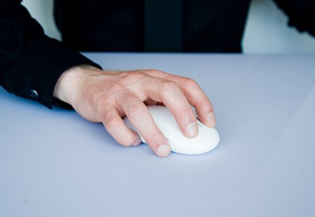 Hand on a wireless mouse
