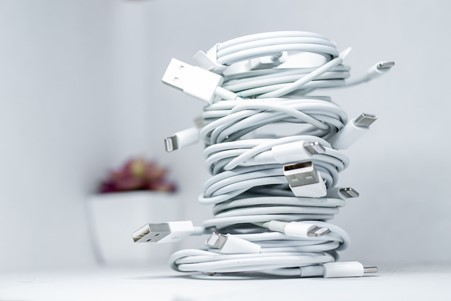 USB wires coiled on a desk