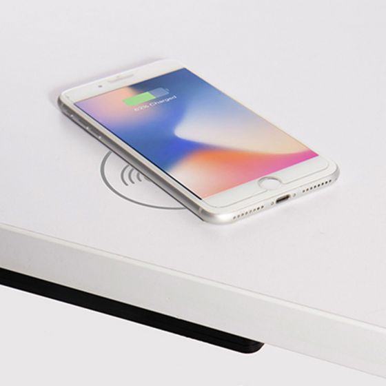 Arc-H Through Desk Wireless Charger - top view, showing iPhone charging