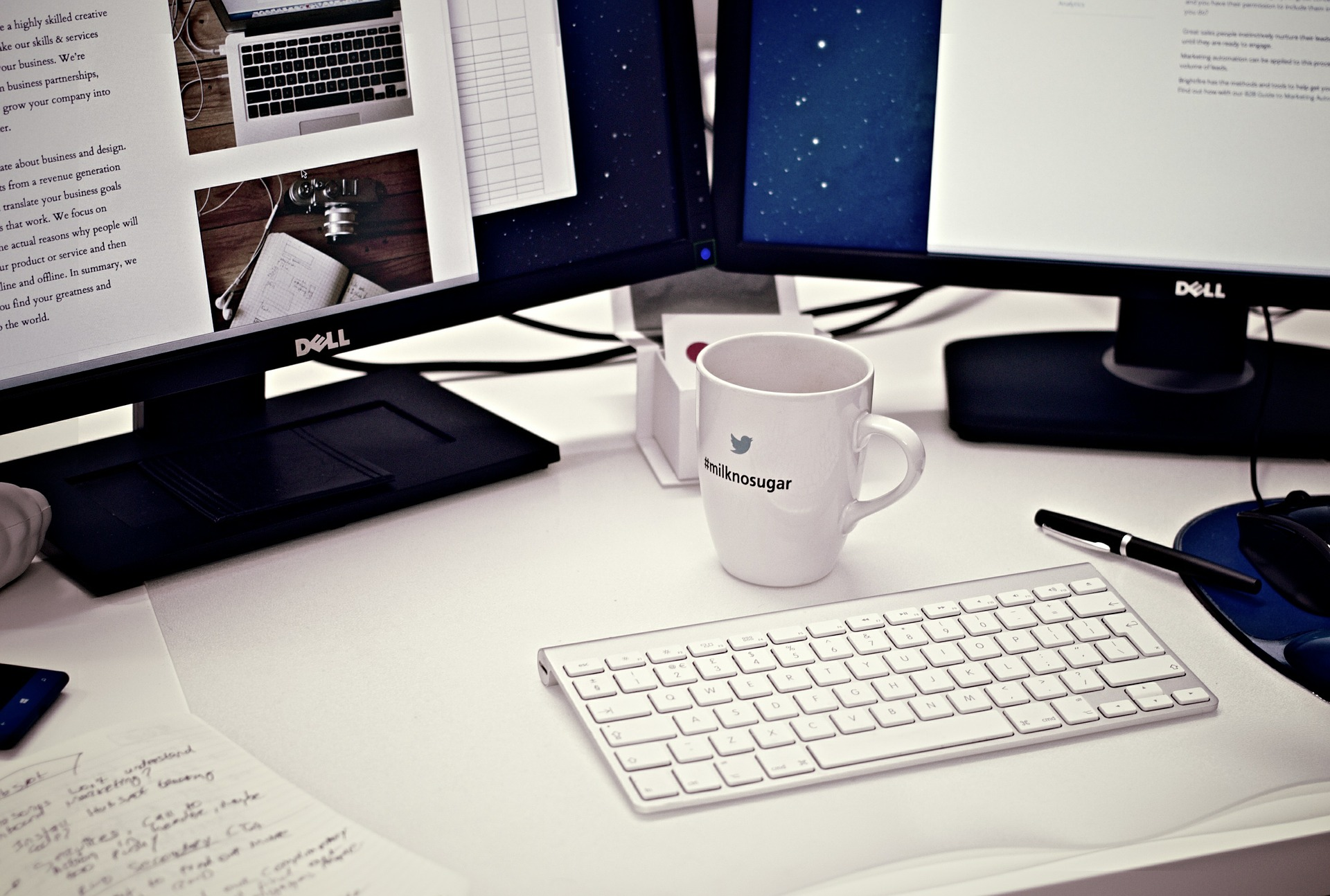 Typical office desk set-up, showing monitors, keyboard and mouse
