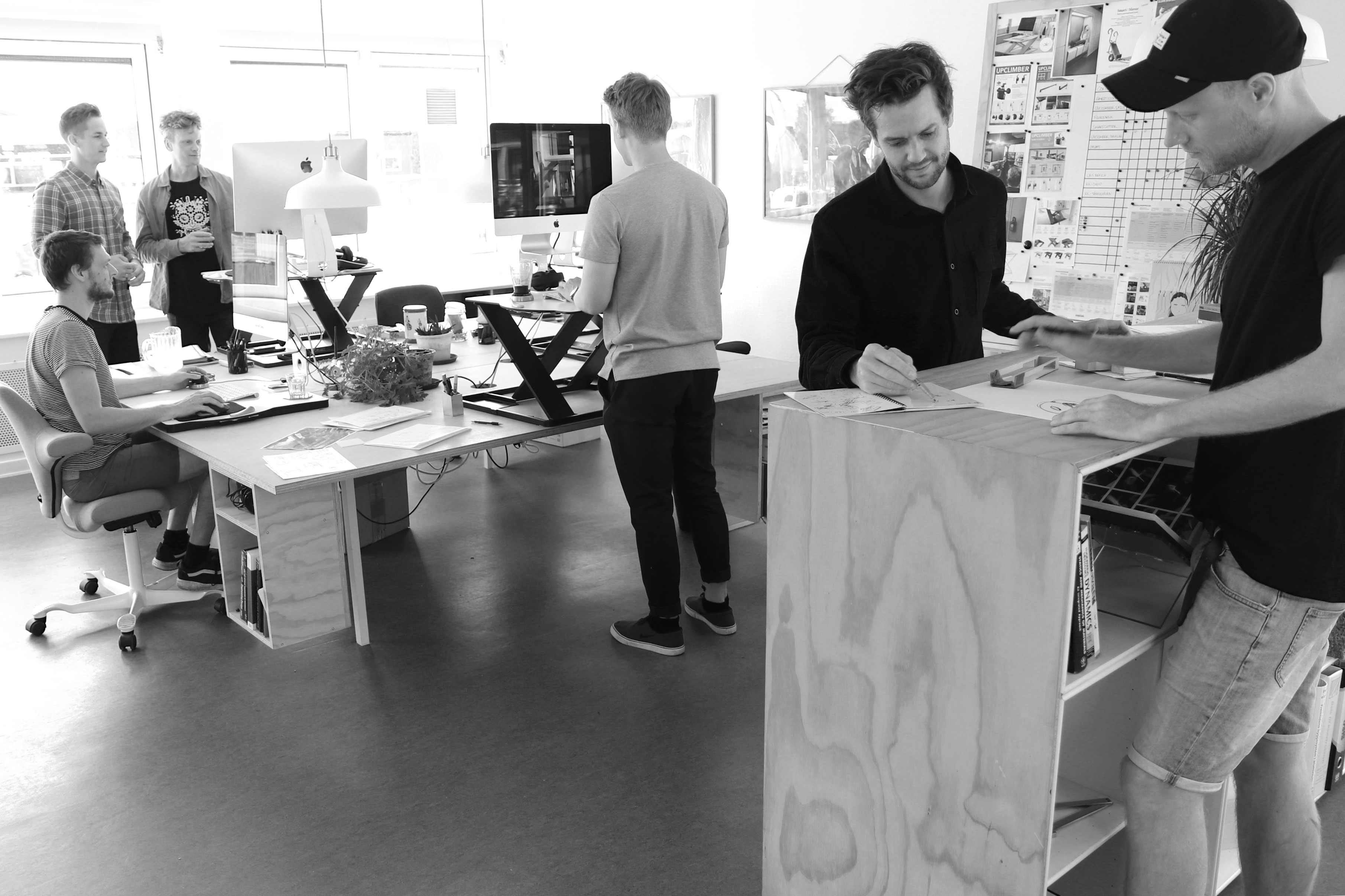 Product designers at Lolle & Nielsen working in their office