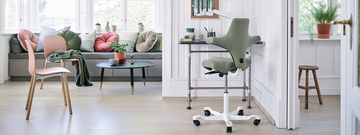 Lifestyle shot showing an ergonomic chair within a home environment
