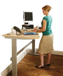 Woman at a height adjustable ergonomic desk