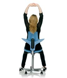 Why order an ergonomic chair - woman stretching on ergo chair